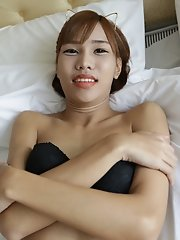 18 year old skinny Thai shemale striptease to black panties and hard cock