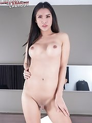 Busty ladyboy Emmy, back with an even sexier body and full of passion. This time have fun watching Emmy as she shows off her ass and cock!